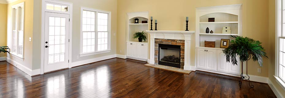 A beautiful hardwood floor enlivens this living room
