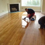 Coating a stained rift & quartered white oak hardwood floor. Seattle, WA